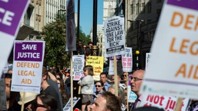 British barristers threaten action over plans to cut legal aid