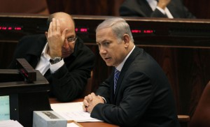 Israel's Prime Minister Netanyahu sits next to Vice Prime Minister Yaalon during a memorial service in Jerusalem