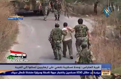 Terrorists arrested by SAA in al-Mitrass village being transported to detention centers, where they will be charged