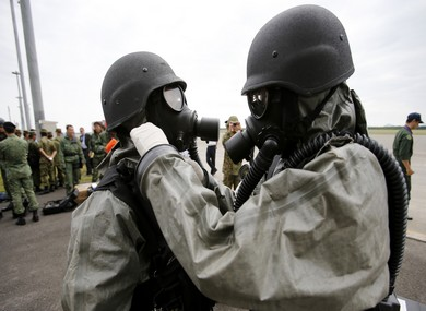South Korean soldiers in protective gear take part in an NBC exercise at Proliferation Security Initiative Air Interdiction Exercise in Chitose, Japan
