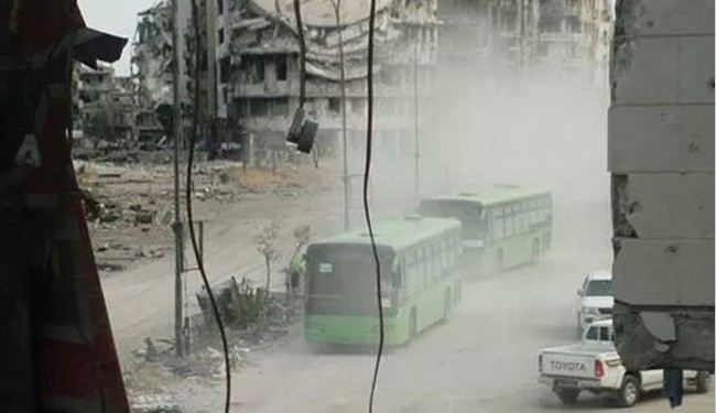Militants start evacuation from Syria's Homs
