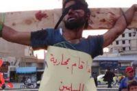 Takfiris crucify two Syria militants