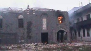 Terrorists in Old Homs burned the church of #Um_Alzinar in #Hamidiya before leaving the district .