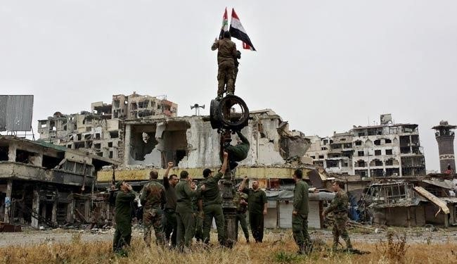 Syrian forces hoist the country's flag over Homs
