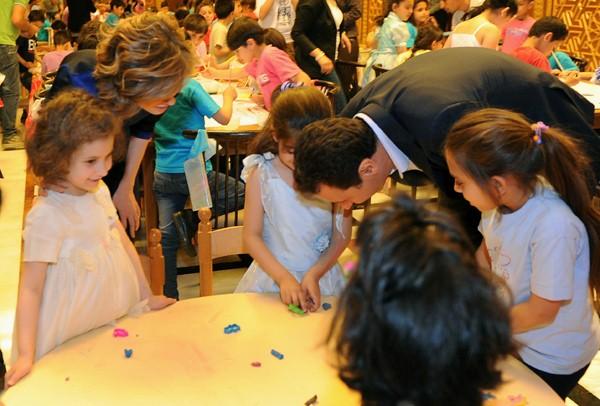 President Assad, his wife Asma greet children of martyrs: Photos