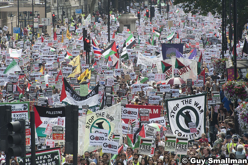 National demonstration in London called over the bombing of Gaza by Israeli forces. The protest called by the Stop the War Coalition, The Palestinian Soldidarity Campaign, CND, War on Want, BMI, IFE and Friends of Al Aqsa marcheds from Downing street to t