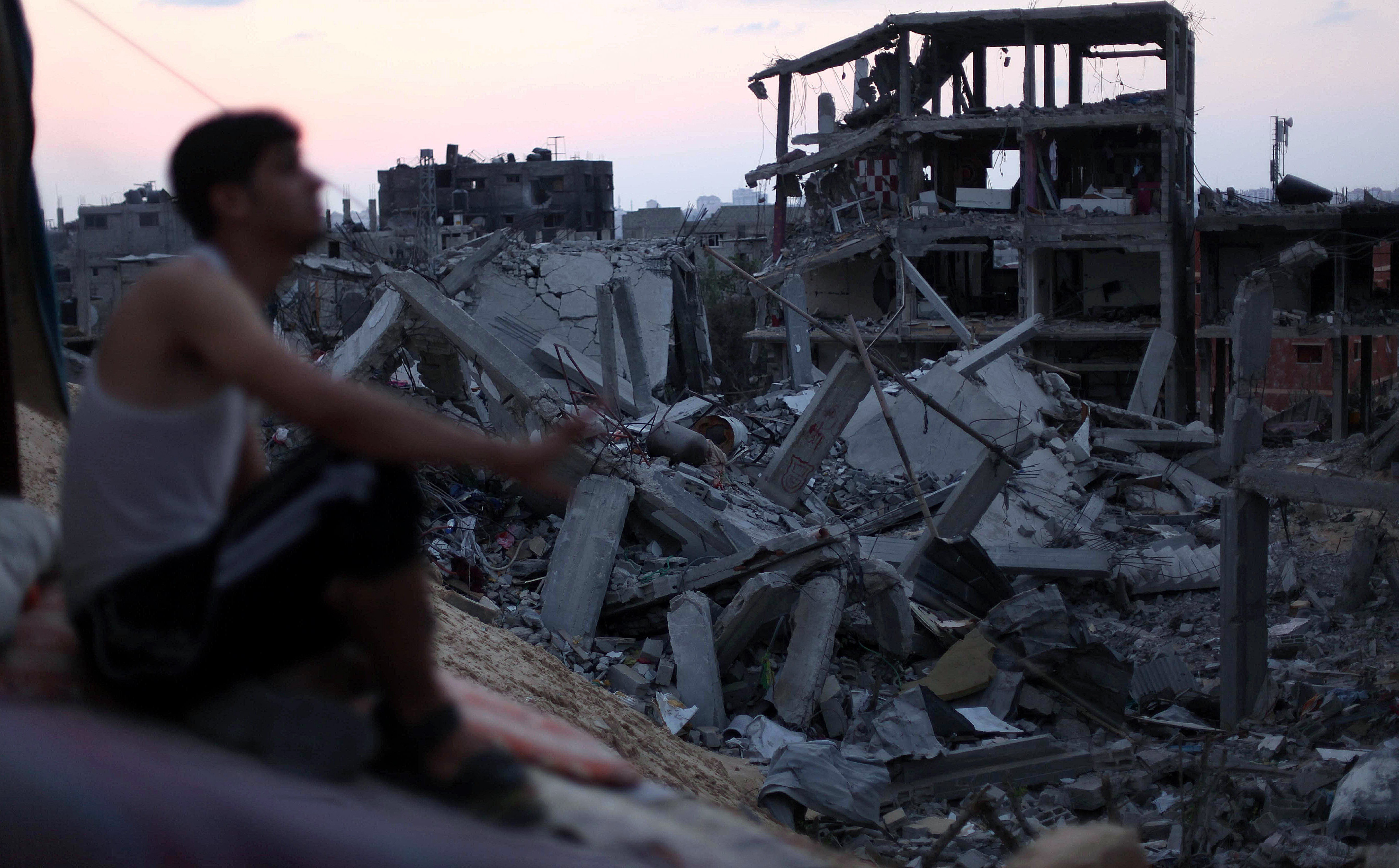 Man-overlooks-destruction-and-rubble-of-buildings-and-homes-in-gaza