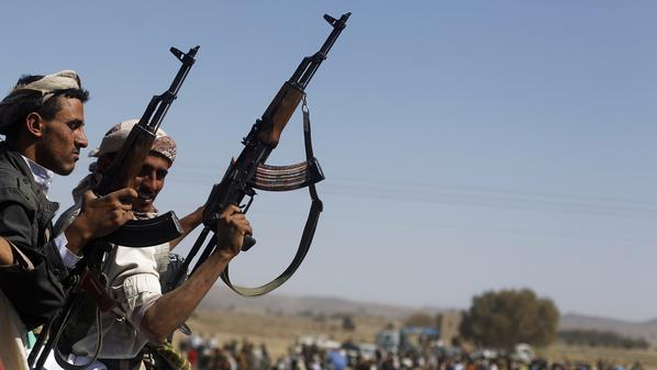 Armed tribesmen backing anti-government protesters escort protesters outside the central Yemeni city of Dhamar