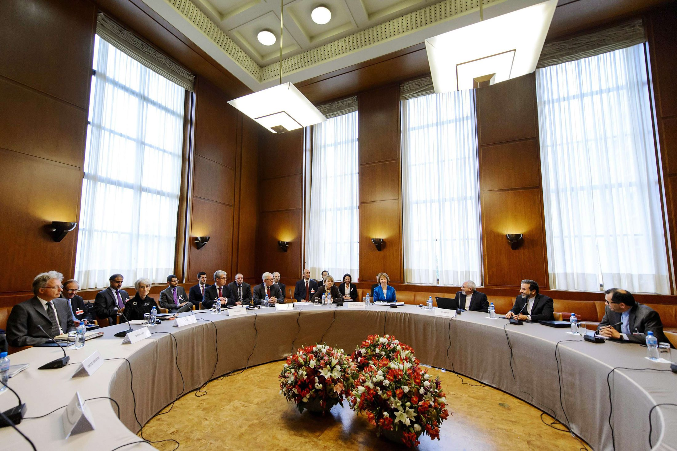 Delegations from Iran and other world powers sit before the start of closed-door nuclear talks at the United Nations offices in Geneva