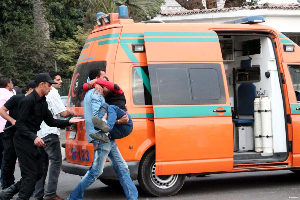 egypt-cairo-bomb-blast-october-2014-injured-being-carried-to-ambulance