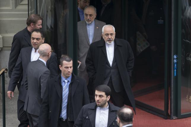 Iran's Foreign Minister Zarif and the head of the Atomic Energy Organization of Iran Salehia depart their hotel to return to Iran following days of negotiations with United States over Iran's nuclear program in Lausanne
