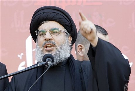 Hezbollah leader Sheik Hassan Nasrallah, speaks to the crowd in a rare public appearance during a rally to mark the Muslim holy day of Ashoura, in the Hezbollah stronghold of south Beirut, Lebanon, on Tuesday Dec. 6, 2011. Sheik Hassan Nasrallah has rarely been seen in public since his Shiite Muslim group battled Israel in a monthlong war in 2006, fearing Israeli assassination. Since then, he has communicated with his followers and gives news conference mostly via satellite link. Ashoura marks the anniversary of the death in the seventh century of the Prophet Muhammad's grandson Imam Hussein. His death in a battle outside of the Iraqi city of Karbala sealed Islam's historical Sunni-Shiite split, which still bedevils the Middle East. Ashoura is one of the holiest days of the Muslim Shiite calendar.  (AP Photo/Bilal Hussein)