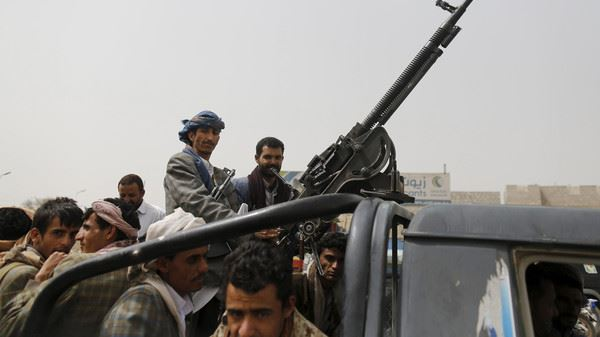 Houthi fighters ride a patrol truck outside Sanaa Airport March 28, 2015. Saudi-led air forces struck a convoy of Yemeni Houthi fighters advancing on Aden from the east on Saturday, residents said, and the Saudi navy evacuated diplomats from the southern port city. REUTERS/Khaled Abdullah TPX IMAGES OF THE DAY