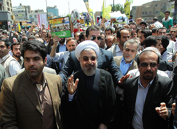 "A handout picture released by the official website of the Iranian President Hassan Rouhani shows him attending  Quds (Jerusalem) Day demonstration in Tehran on July 25, 2014. Iranians rallied nationwide on Friday in a show of support for Palestinians and to protest against Israel as the Jewish state pursued its deadly campaign against the Gaza Strip enclave. The Islamic republic holds Quds Day rallies in support of the Palestinians every year since the early 1980s on the last Friday of Ramadan, but this year's demonstrations came on the 18th day of Israel's deadly campaign in Gaza which has so far killed more than 800 Palestinians. AFP PHOTO/IRANIAN PRESIDENCY WEBSITE/HO        == RESTRICTED TO EDITORIAL USE - MANDATORY CREDIT ""AFP PHOTO / IRANIAN PRESIDENCY WEBSITE"" - NO MARKETING NO ADVERTISING CAMPAIGNS - DISTRIBUTED AS A SERVICE TO CLIENTS =="