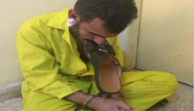 Pics: ISIS Terrorist Humiliated on TV, Forced to Chew a Sandal