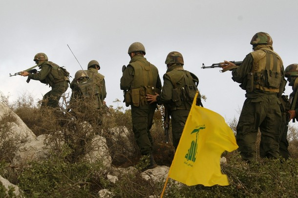 A group of Hezbollah fighters take position in Sujoud village in south Lebanon September 13, 2008. Hezbollah reproduced the operation attack on an Israeli occupation position made by Hadi Nasrallah, a Hezbollah fighter and the eldest son of the group's leader Sayyed Hassan Nasrallah, to commemorate his death during the operation in September 13, 1997. REUTERS/ Ali Hashisho (LEBANON)