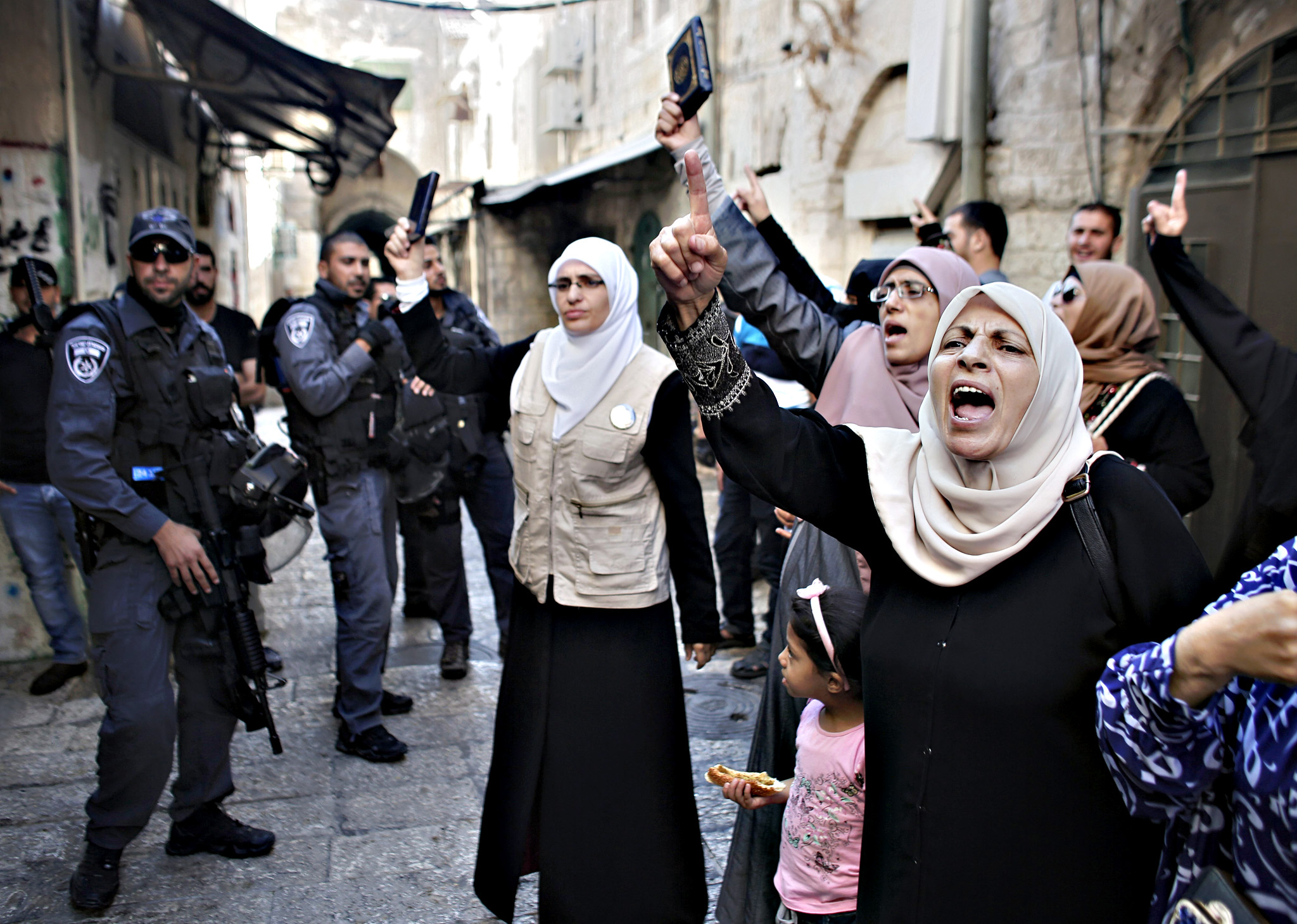 Palestinian women from the so-called Mur...Palestinian women from the so-called Murrabit group raise copies of the Koran, Islam's holy book, and shout slogans in front of Israeli security forces during a protest against Jewish groups visiting the Al-Aqsa mosque compound in Jerusalems old city on September 22, 2015. Israel said thousands of police would be deployed in Jerusalem ahead of the Yom Kippur and Eid al-Adha holidays after three days of clashes rocked the Al-Aqsa mosque compound. AFP PHOTO / AHMAD GHARABLIAHMAD GHARABLI/AFP/Getty Images
