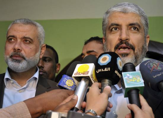 Hamas leader Khaled Meshaal (R) speaks to the media with Hamas' Gaza leader Ismail Haniyeh after meeting Sudan's President Omar al-Bashir in Khartoum December 29, 2011. REUTERS/ Mohamed Nureldin Abdallah (SUDAN - Tags: POLITICS)