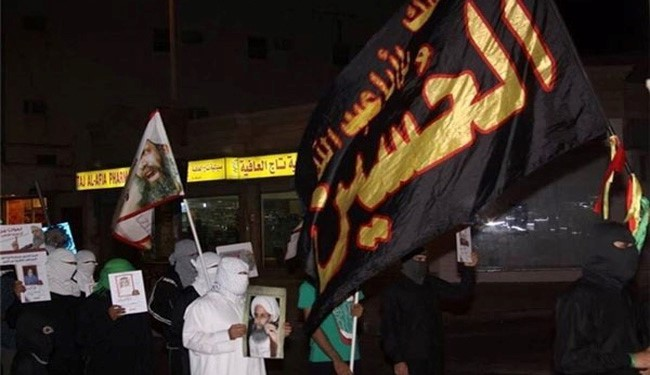Photos: Saudi Protesters Warn against Execution of Sheikh Nimr