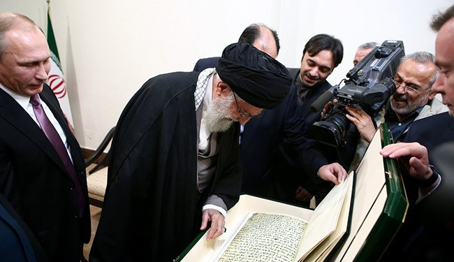 Photos: Putin offered an old Quran manuscript to Ayatollah Khamenei