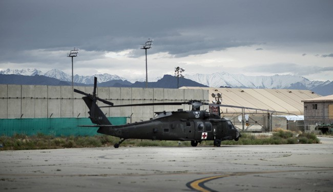 (File --- A US Blackhawk helicopter at Bagram Airfield some 60kms north of Kabul ) 11 Killed and Injured in Suicide Attack Near US Airbase in Afghanistan