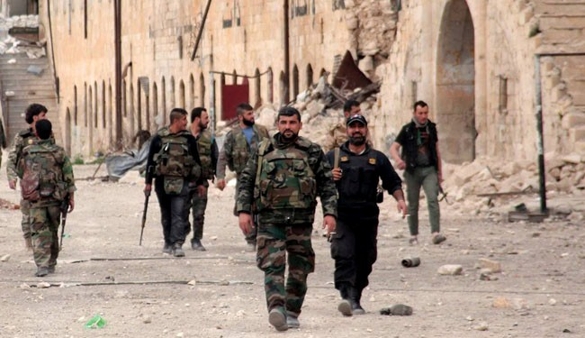 A handout picture released by the official Syrian Arab News Agency (SANA) shows Syrian Army soldiers walking around the government-controlled Hanano barracks in Aleppo, on April 17, 2014.