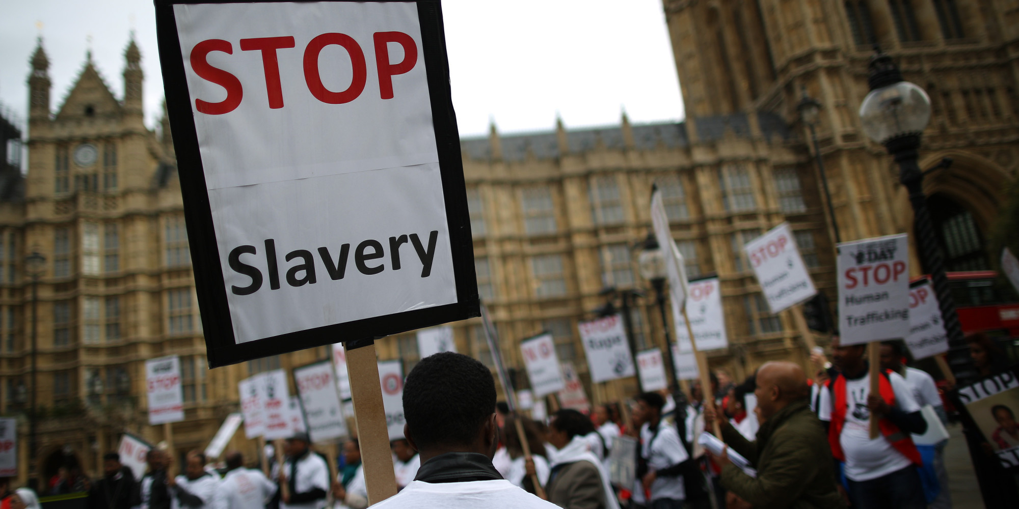 LONDON, ENGLAND - OCTOBER 18:  Anti-slavery activists rally outside Parliament on October 18, 2013 in London, England. Anti-slavery day falls on October 18th every year and provides an opportunity to draw attention to the scale and scope of human trafficking.  (Photo by Peter Macdiarmid/Getty Images)