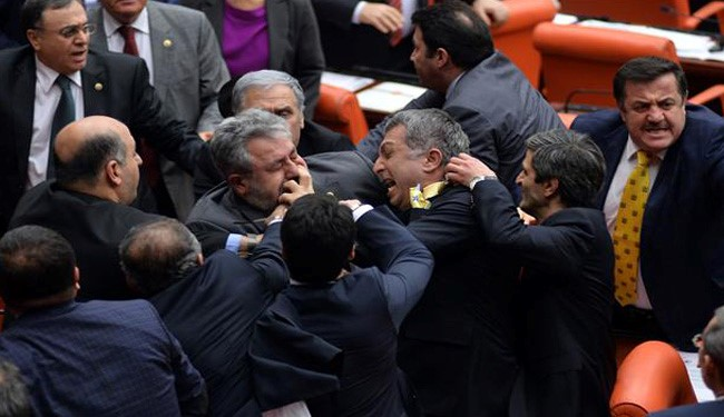 VIDEO: Fist Fighting Erupts in Turkey Parliament over Immunity Proposal