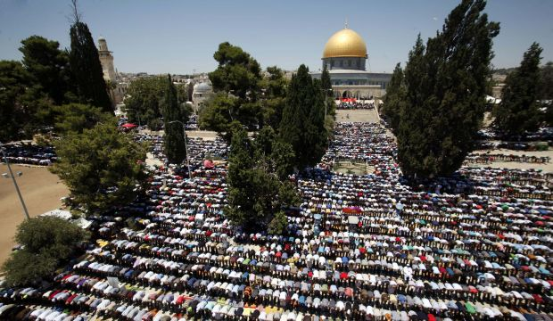 FILE - In this Friday, July 10, 2015 file photo, Palestinian men pray at the Al-Aqsa Mosque compound during the Muslim holy month of Ramadan. A rectangular hilltop compound in Jerusalem is ground zero of the Israeli-Palestinian conflict. Known to Muslims as the Noble Sanctuary, it is Islam's third holiest spot and is home to an iconic golden-domed shrine. But to Jews it is the Temple Mount, their holiest place. This sensitive arrangement, and attempts to change it, lie at the heart of the unrest that rocked Jerusalem this week. (AP Photo/Mahmoud Illean, File)