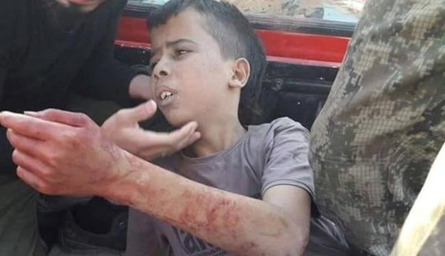 SHOCKING PICS: West Backed Syrian Moderate Rebels Beheads a Child