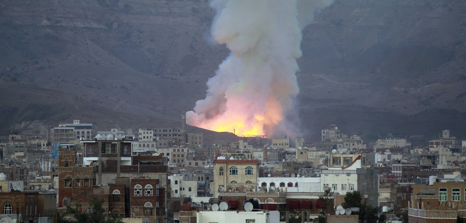 Smoke billows following an air-strike by Saudi-led coalition on May 11, 2015, in the capital Sanaa. The raid targeted an arms depot in the Mount Noqum area on the eastern outskirts of Sanaa, triggering several blasts, an AFP correspondent and witnesses said. AFP PHOTO / MOHAMMED HUWAIS        (Photo credit should read MOHAMMED HUWAIS/AFP/Getty Images)