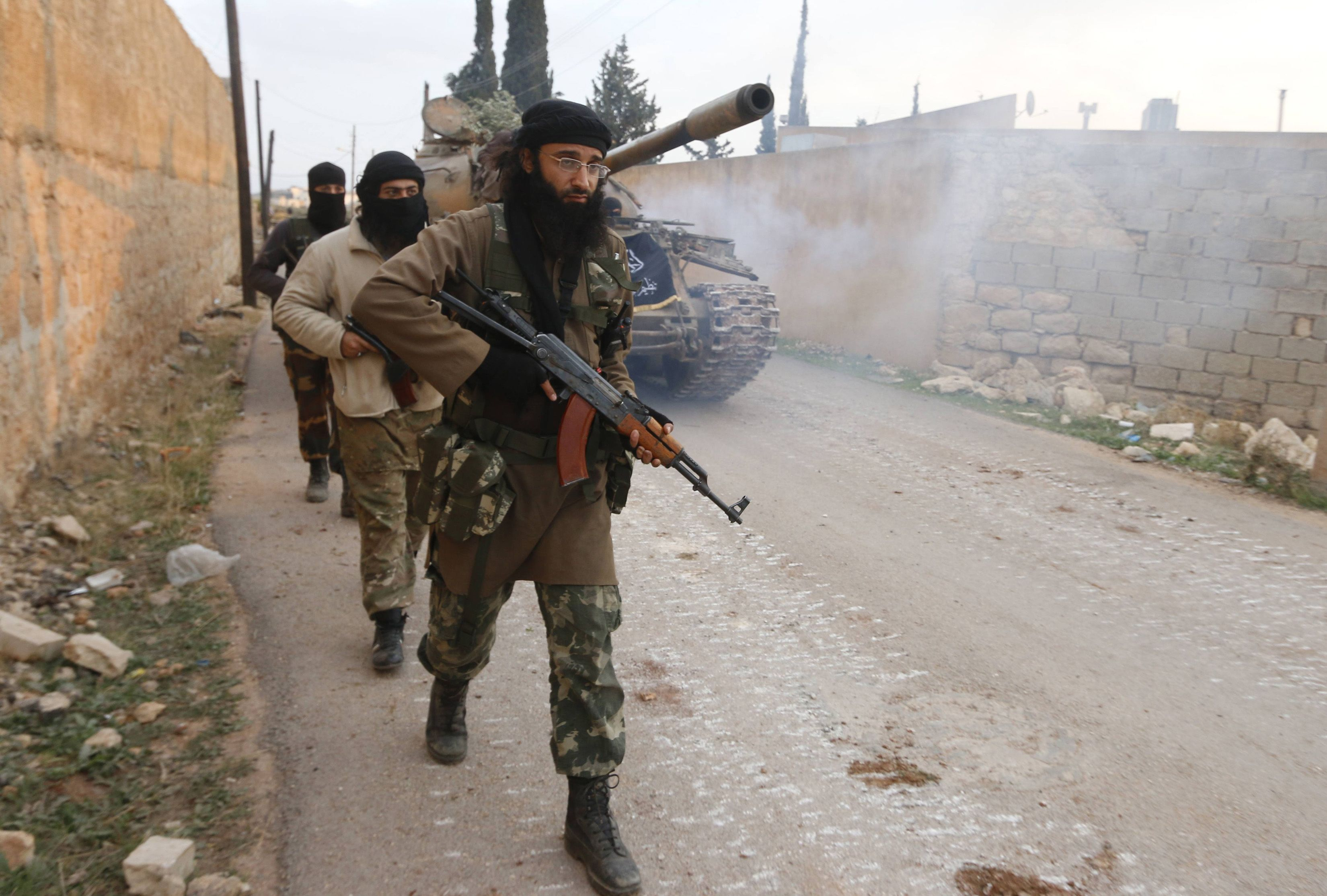 Members of al Qaeda's Nusra Front carry their weapons as they walk near al-Zahra village, north of Aleppo city, November 25, 2014. Members of al Qaeda's Nusra Front and other Sunni Islamists seized an area south of the Shi'ite Muslim village in north Syria on Sunday after clashes with pro-government fighters, opposition activists said. The insurgents advanced overnight on al-Zahra, north of Aleppo city, seizing territory to the south and also trying to take land to the east in an attempt to capture the village, the Britain-based Syrian Observatory for Human Rights said.  Picture taken November 25, 2014. REUTERS/Hosam Katan    (SYRIA - Tags: POLITICS CIVIL UNREST CONFLICT)