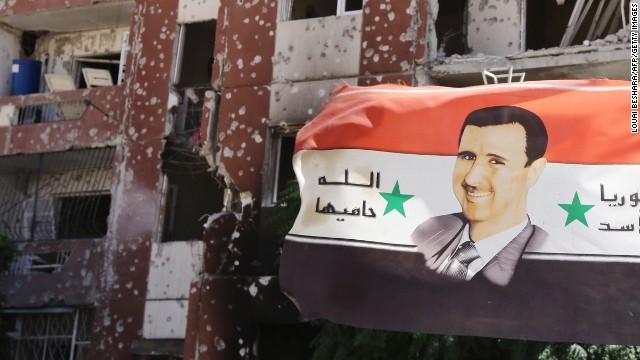 141031134713-assad-poster-adra-syria-story-top