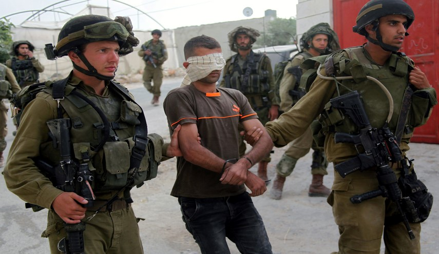Zionist Forces Arrest 18 Palestinians in West Bank Raids