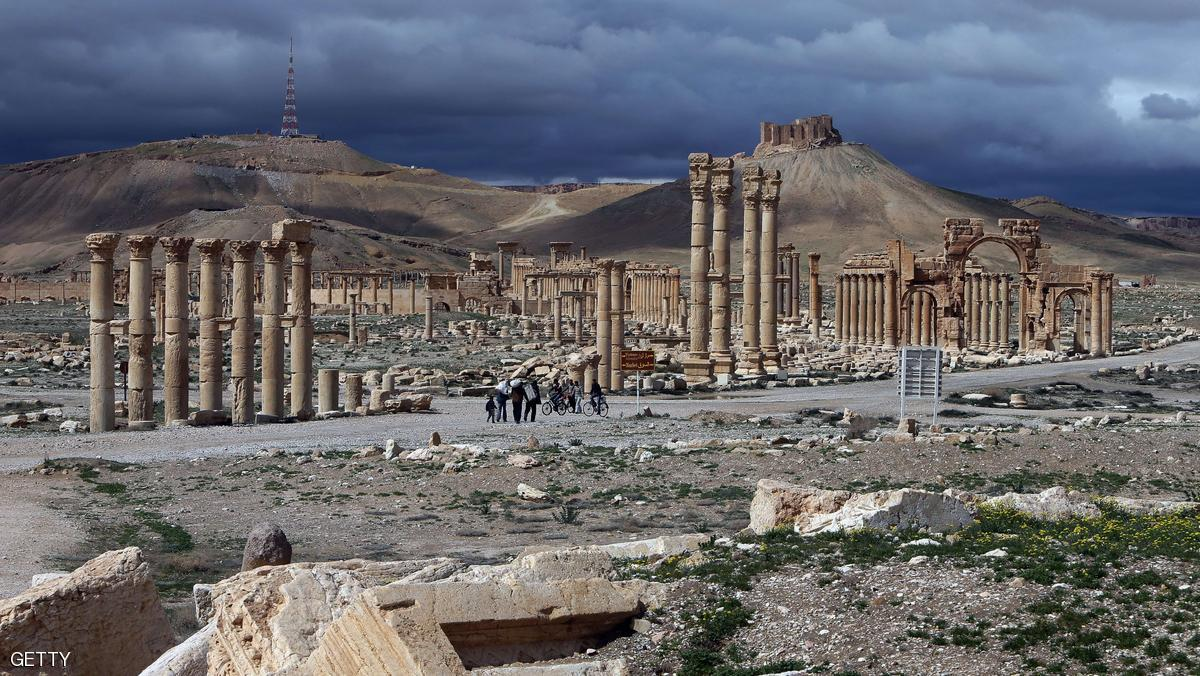 A picture taken on March 14, 2014 shows the citadel (background) of the ancient oasis city of Palmyra, 215 kilometres northeast of Damascus, over looking the city. From the 1st to the 2nd century, the art and architecture of Palmyra, standing at the crossroads of several civilizations, married Graeco-Roman techniques with local traditions and Persian influences. AFP PHOTO/JOSEPH EID        (Photo credit should read JOSEPH EID/AFP/Getty Images)