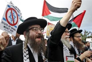 Photo of Palestinians mark anniversary of war on Gaza