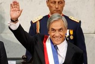 Photo of Chilean president swears in amid strong quake