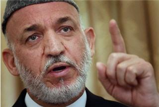 Photo of Karzai urges Obama to review Afghan war