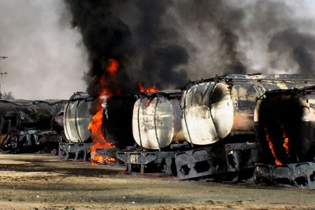 Photo of NATO tankers torched in Pakistan