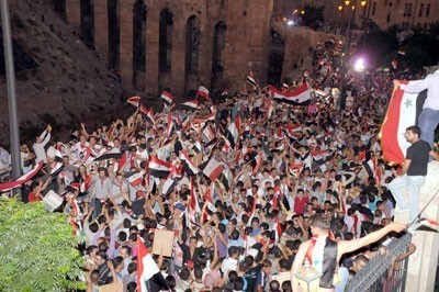 Photo of Syrian Youth Gathering Activities Concluded by Draping Syrian Flag at Aleppo Citadel