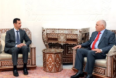 Photo of Iraqi President Stressing his Country's Support to Syria against Schemes Targeting its Security and Stability