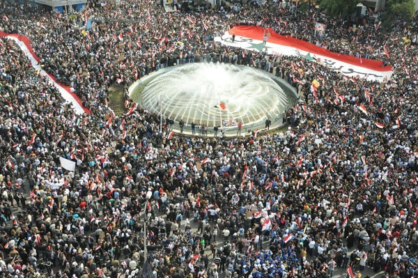Photo of Millions of Syrians Flock to Public Squares in Rejection of Arab League's Decision