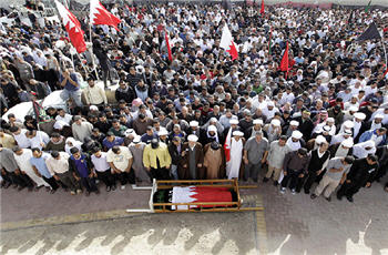 Photo of The king must go, Bahraini mourners cry