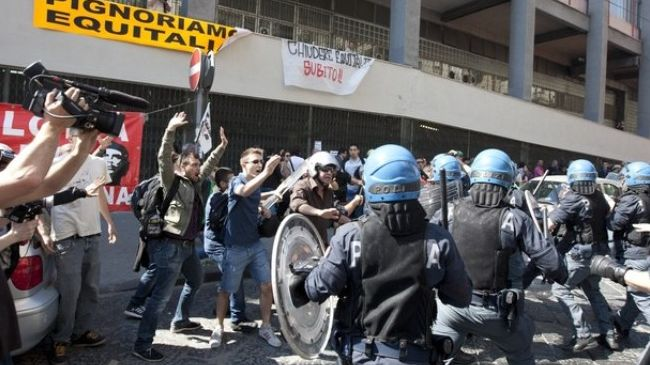 Photo of European Awakeing: Police clash with anti-austerity protesters in Italy