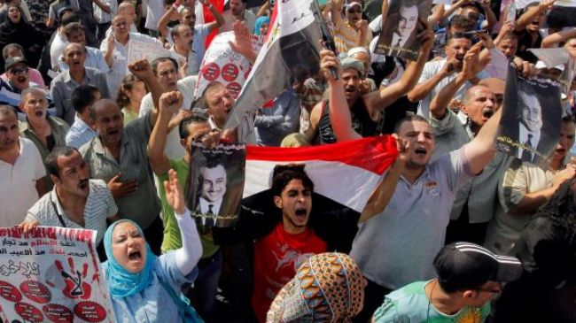 Photo of Egyptians accuse Morsi of failing to deliver on his promises