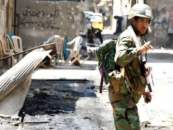 Photo of Syrian Army cleaning Homs from Us-Isarel backed terrorists