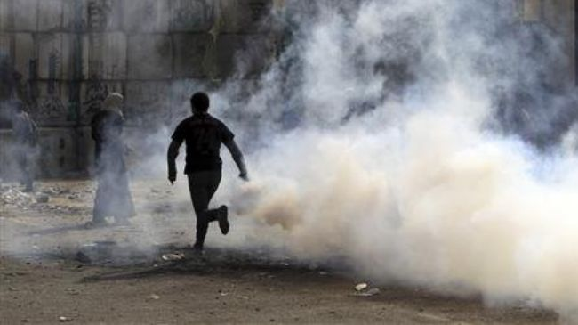 Photo of Over 60 injured as protesters clash with Egyptian police