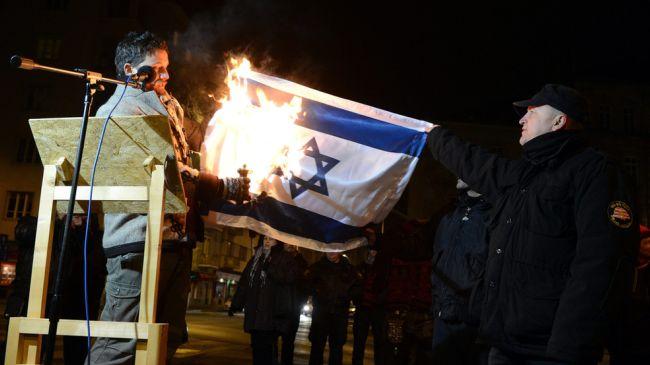 Photo of Hungarian MP detained for burning Israeli flag