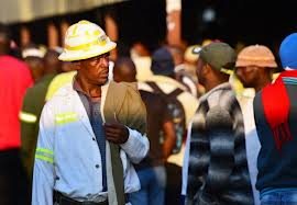 Photo of S. African workers clash with security guards at Harmony mine