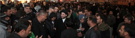 Photo of Sayyid Ammar al-Hakim is honored by visiting the Shrine of the Commander of the Faithful Ali ibn Abu Talib A